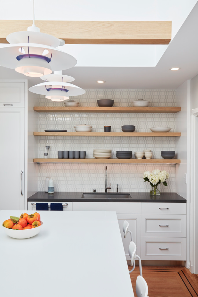 The open shelves over the sink are clear finished white oak.  A Danish Inspired Kitchen