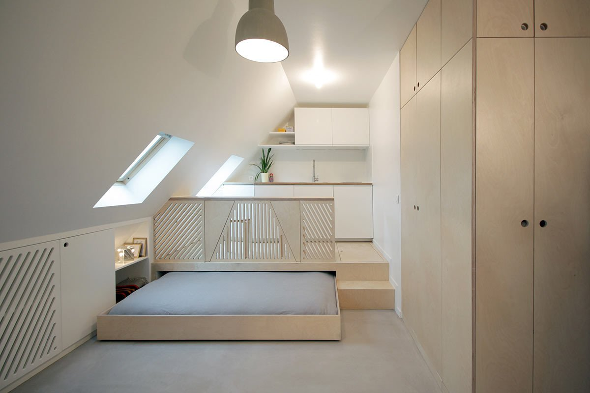 A mansard-roofed Parisian apartment was renovated by Batiik Studio to incorporate millwork and cabinetry which was custom-built for the sloped walls of the attic space.  Photo 8 of 16 in Guide to 7 Main Types of Roofs and What You Need to Know About Them