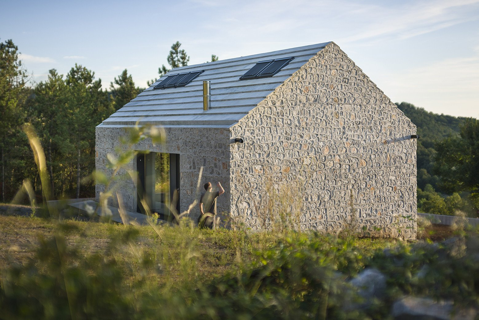 Exterior, Cabin Building Type, and Stone Siding Material Compact Karst House by dekleva gregorič arhitekti  Photo 5 of 16 in These 4 Modern Homes Around the World Take Advantage of Local Stone