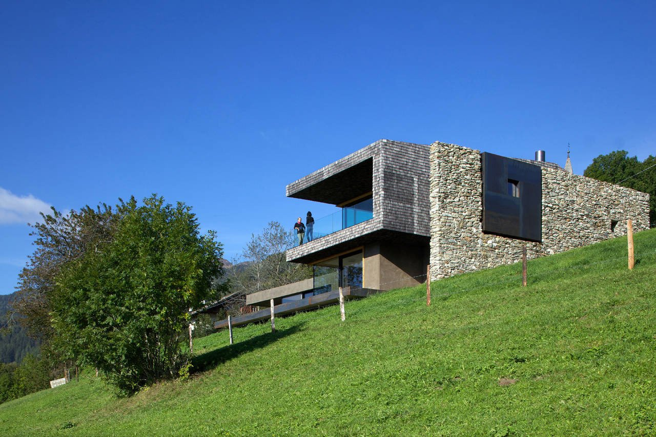 Exterior, House Building Type, Cabin Building Type, Stone Siding Material, Metal Siding Material, and Wood Siding Material The home's location in Sterzing, Italy meant that it was surrounded by a rural green landscape, and the architects sought to change it as little as possible.  Photo 7 of 19 in Rising From the Ruins: Homes Built on Architectural Remains