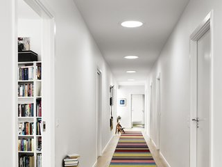 A series of three sun tunnels, or sun pipes, brighten up a windowless corridor.