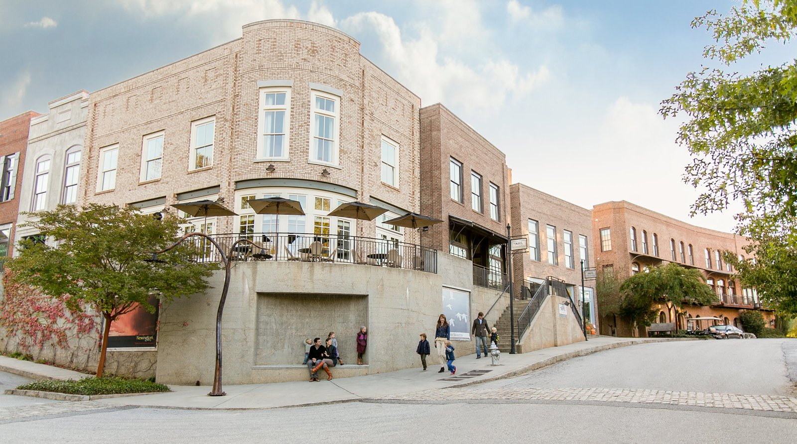Housing includes loft-like apartments and townhouses in a range of more traditional styles, with double-hung, operable windows and brick facades.  Photo 4 of 11 in An Eco-Friendly Community Outside of Atlanta Celebrates Nature and Sustainability