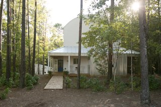 Farmhouse-style homes feature corrugated metal, standing-seam metal roofs, and wood siding.