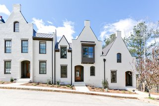 Even townhouses located next to each other are distinct while featuring the same architectural language.