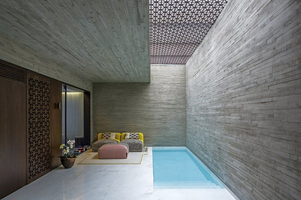 Outdoor, Small Pools, Tubs, Shower, and Plunge Pools, Tubs, Shower The use of the two types of concrete continues throughout the project, both on the interior and the exterior spaces.  Photo 7 of 11 in 5 Striking Designs That Use Perforated Cement Breeze-Blocks in Interesting Ways
