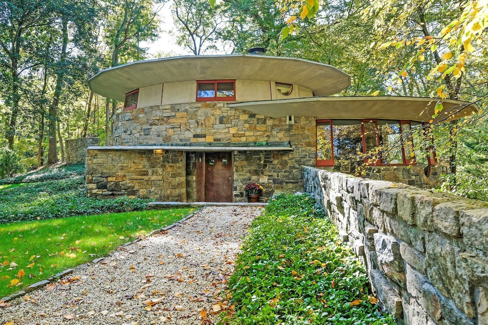 Exterior, Stone Siding Material, Concrete Siding Material, and House Building Type Built in 1948 and named 'Toyhill' by Wright himself, this Usonian home is considered an artistic masterpiece and shows Wright's early interest in overlapping circular masonry, which would become an innovative and iconic treatment found in his later work—including the Guggenheim Museum.  Photo 2 of 7 in What You Need to Know About Frank Lloyd Wright's Usonian Homes