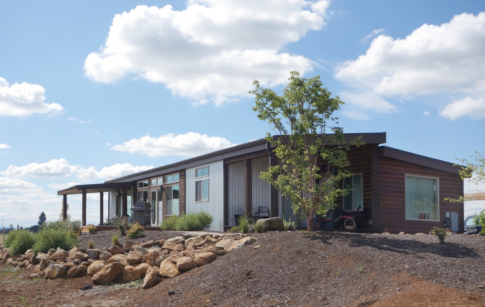 Exterior, Metal Siding Material, Metal Roof Material, Wood Siding Material, Prefab Building Type, and House Building Type Salem, Oregon-based Ideabox approaches prefabricated homes from a modern and sustainable point of view, seeking to build prefab residences that are beautiful, efficient, and affordable. With 9 basic types that can be customized, the homes start at 400-500 square feet and reach about 1,600 square feet. Each home is built with open-web engineered trusses, insulation with high R-values, dual pane low-e windows, and EnergyStar-certified appliances.  Photo 5 of 7 in 7 Prefab Companies That Oregon Dwellers Should Know