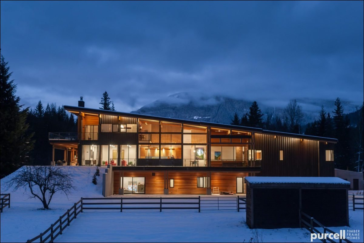 Exterior, Wood Siding Material, Metal Siding Material, House Building Type, and Prefab Building Type Purcell Timber Frame Homes is, as they say, a product of their environment: the beautiful Kootenay mountains of Nelson, British Columbia. They've developed a strong relationship with the local forests, and build prefabricated, packaged, and fully-customized homes in British Columbia and Alberta, Canada as well as several states in the Pacific Northwest, including Oregon. Their homes feature natural timber frames, and their catalogue collection includes bungalows, beach houses, ski chalets, cabins, and cottages that are designed to perform with the elements and be low-maintenance.  Photo 3 of 7 in 7 Prefab Companies That Oregon Dwellers Should Know