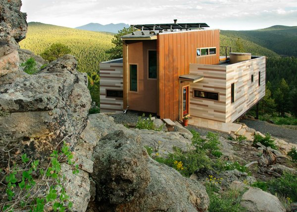 Winner of an AIA Colorado Citation Award, the Container House is a 1,500-square-foot container home that includes recycled materials, green roofs, and a photovoltaic system.