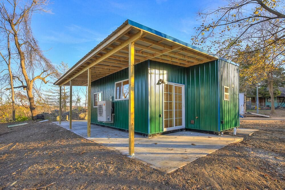 Exterior, House Building Type, Metal Siding Material, Shipping Container Building Type, Metal Roof Material, and Flat RoofLine Happy Twogether by Custom Container Living  Photo 6 of 11 in 10 Shipping Container Homes You Can Buy Right Now