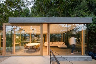 Some of the large planes of glass are sliding doors that open to the outside.