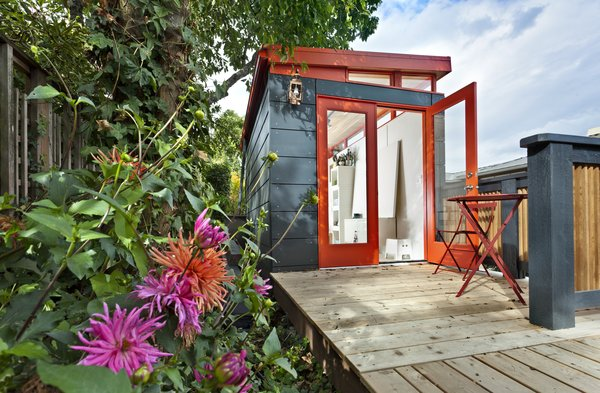 In Seattle, an artist sought an affordable option for her own studio and looked to Modern Shed, a company that provides solutions for storage and limited living spaces like studios and office sheds. Metal panels in gray and red clad the exterior, and natural light pours in through glazed double doors and clerestory windows.