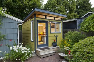 When a homeowner needed extra space for her growing business, she also looked no further than Modern Shed for her minimalist she shed, with a sloped roof, clerestory windows, and personalized window and door locations. A color scheme that worked with the colors of her historic home also on the property gave it its finishing touches.
