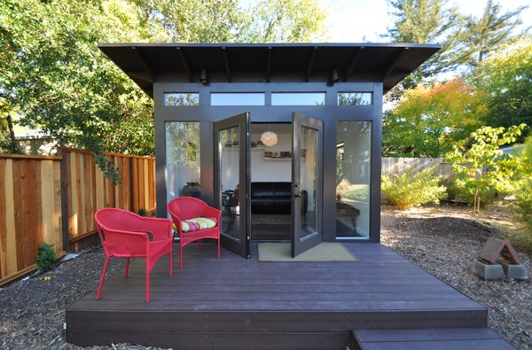 With a front facade of glass, inviting double doors, and engineered wood cladding, this prefabricated she-shed was designed by Studio Shed and is often used as a home office for women starting their own businesses or who wish to work without leaving their children for the day.