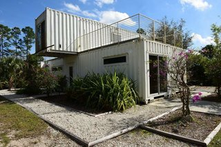 Functioning as a vacation rental for tourists, entrepreneur Rick Clegg combined old shipping containers to create a four-bedroom home with an eco twist near Palm Beach, Florida. Because of the container's inherent durability, they meet Florida's stringent construction standards, and the compactness of the home, the low carbon footprint because of the use of the recycled, prefabricated containers, and the home's proximity to the Loxahatchee River, make it ideal for ecotourists.