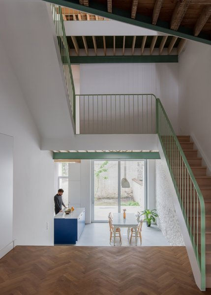 Located in the center of the home, the simple, yet striking staircase connects three floors.