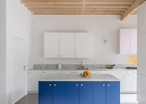 The Kitchenu0027s White Palette Allows The Bright Blue Cabinets And Gold  Hardware To Stand ...