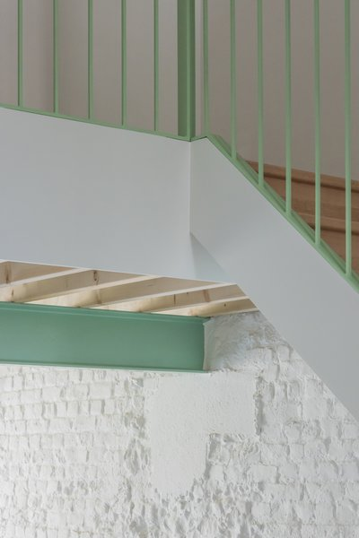 A detail of the mint green stair railing, where old meets new.