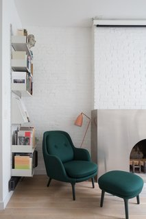 White shelving blends in seamlessly with the crisp, white walls.