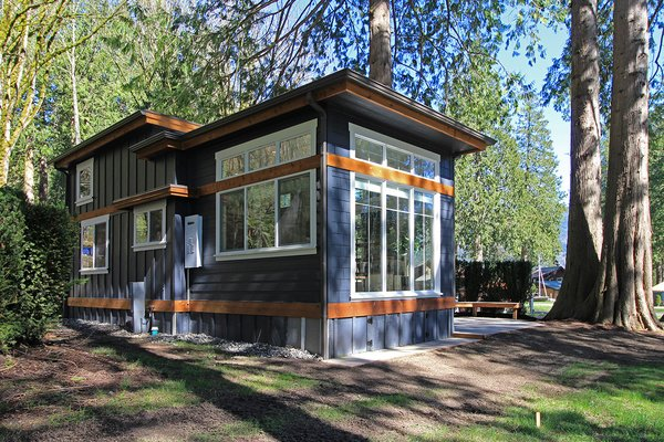 With its many windows bringing in lots of natural light, the interiors of The Salish by West Coast Homes has a kitchen with a rolling island that also functions as a dining table, allowing it to be tucked away when not in use.