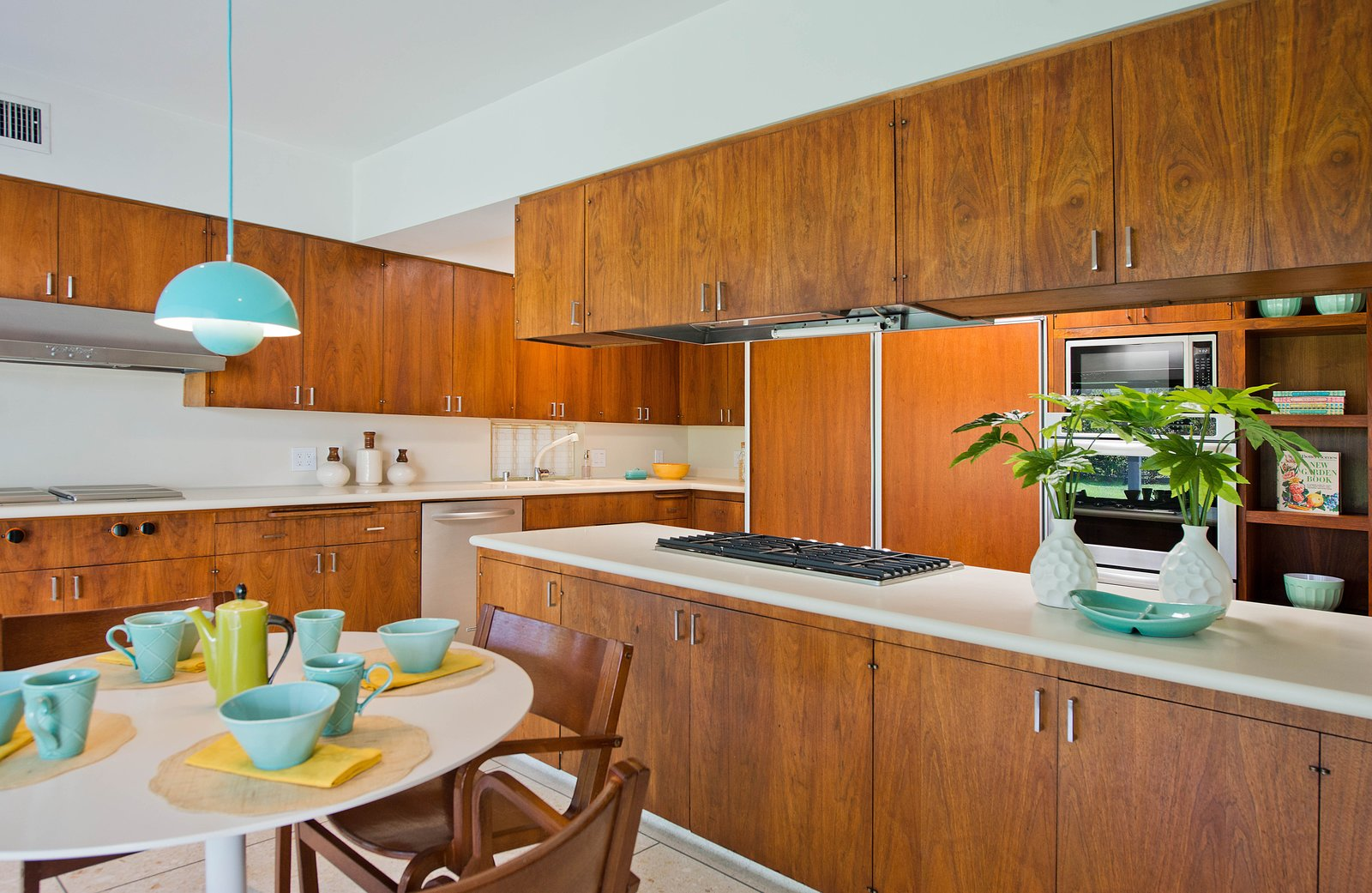 Kitchen, Dishwasher, Wall Oven, Range, Cooktops, Range Hood, Terrazzo, Refrigerator, Pendant, Microwave, and Wood The charming kitchen retains its original walnut cabinets.    Best Kitchen Microwave Range Hood Wood Pendant Photos from An Alluring Kazumi Adachi Home Is Listed For $1.79M