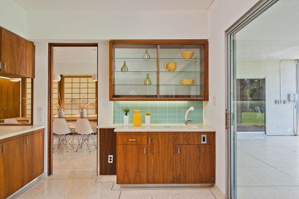 An Updated Bar Area Is Conveniently Adjacent To The Kitchen And Outdoor Patio