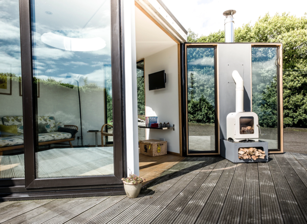 HiveHaus, a UK–based company, designs modern prefab living spaces for a variety of applications. Their prefabricated modules come in the shape of hexagons, and are adaptable, affordable, sustainable, flexible, and easy to construct. These designs consist of a standardized set of components that can be connected together to create interconnecting clusters. The modules are prefabricated offsite, and can be installed in as little as two days, depending on the number of modules, access to the site, and site conditions.