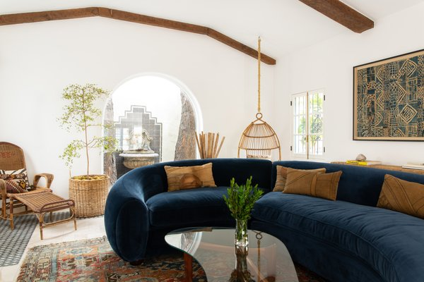 The curved shape of the sofa and its lush texture make for a modern but inviting seat.