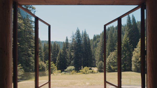 The doors and views open onto the outlying landscape.
