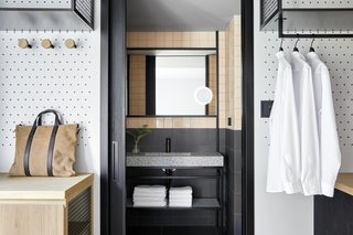 A guest bathroom is revealed with a sliding pocket door.
