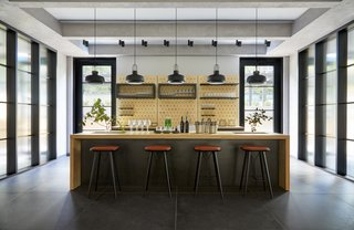 A workshop area in the hotel provides a bar and space for guests to work.