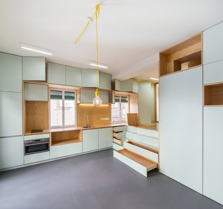 Ample storage is provided in the kitchen area and the steps leading up to the bed.