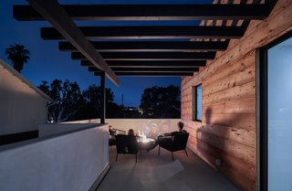 The family often spends evenings in front of the fire pit on the outdoor patio on the second floor.