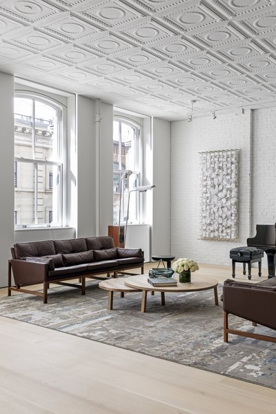 The loft features high ceilings and tall windows that provide lots of daylight. Charette selected and arranged furniture to complement these features.