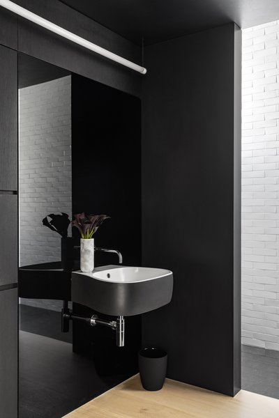 The bathroom is mostly black, allowing selected moments of white to really pop.