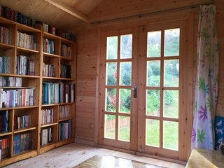This library she shed comes as a kit from Australia-based SheShedz; in addition to its use as a library, the she shed also functions as a music room.