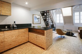 The apartment is located on the top floor of an 1830s building in Paris' 5th arrondissement.