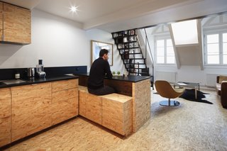 A portion of the countertop slides out to serve as a table, while storage below functions as seating.