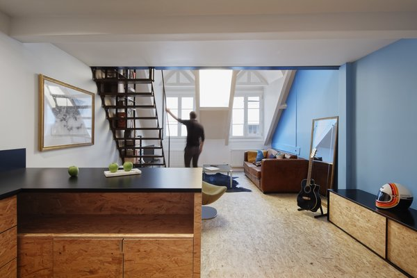 The apartment measures just under 540 square feet. Natural light streams in from two dormer windows and skylights on the upper level.