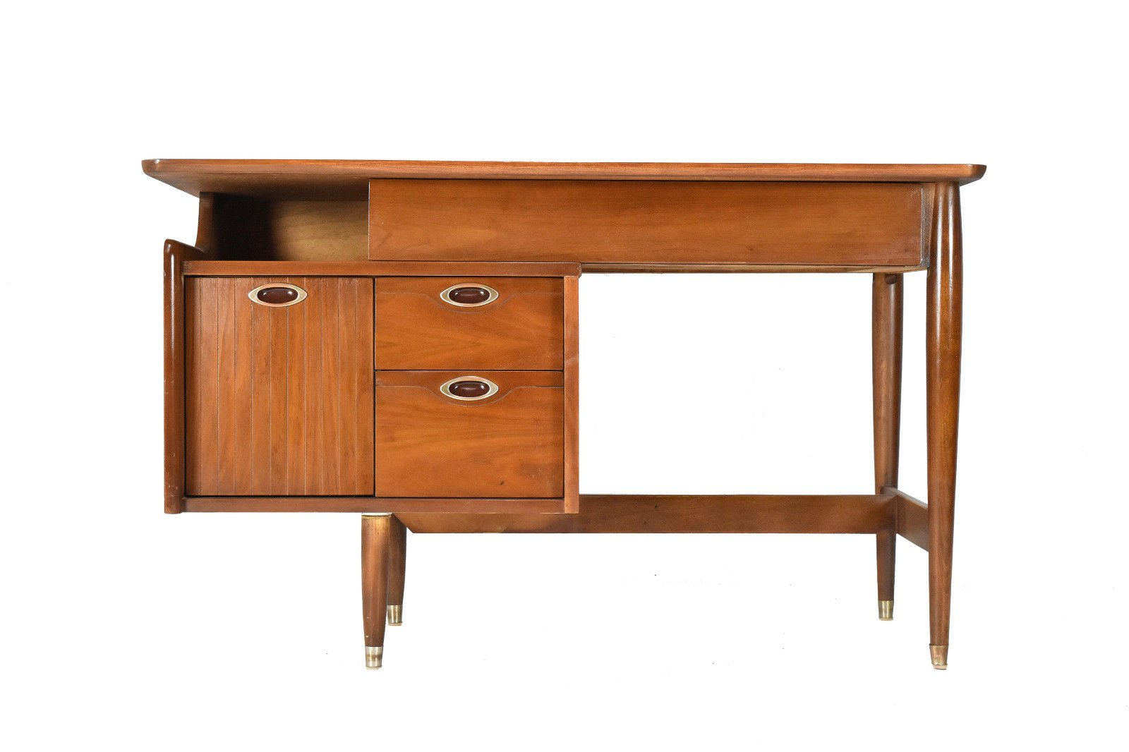 this piece from hooker furnitures 1960s mainline series features unique oval hardware slim desk legs and a mixture of solid walnut and walnut veneer hooker furniture began crafting furniture in 1924 in virginia and continues to produce furniture in virgin