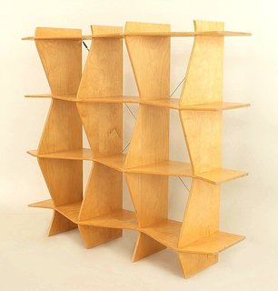 Made out of four vertical panels and four horizontal shelves of blond wood, this midcentury shelving unit would function great as a room divider or as a freestanding shelf. The alternating zigzag shape of the vertical and horizontal members makes for a complex form that is both graphic and exciting. We'd let this piece be the star of the room, and we'd be careful not to overload it with items.