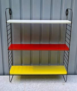 Originally founded as a kitchenware company in the Netherlands in the 1920s, Tomado began making metal items (including cookware, small appliances, and storage solutions) in the 1940s and 1950s. This set of metal shelves is a great example of the types of pieces they made—it's highly functional, easy to assemble, and brightly colored, reminiscent of the Dutch De Stijl movement.
