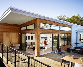 With large expanses of glazing and sliding glass doors that open onto the deck, the 1,500 square feet of the Luna model by Ma Modular is light-filled and open to the outdoors. It has three bedrooms and two full bathrooms.
