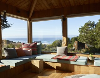 The Rush House at Sea Ranch followed the typical material palette of wood and glass; windows were located specifically so that they took advantage of views of the water and the surrounding landscape.