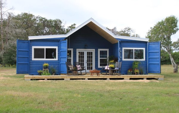 This custom build by Backcountry Containers comprises two 40-foot-long containers connected by a more traditional stick-built great room.