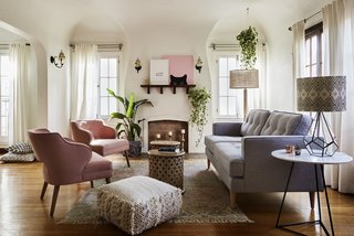At a project in Los Angeles, AphroChic used warm pinks and grays, along with lots of greenery, to bring the outdoors in and make this Mission-style home classic and yet up-to-date.
