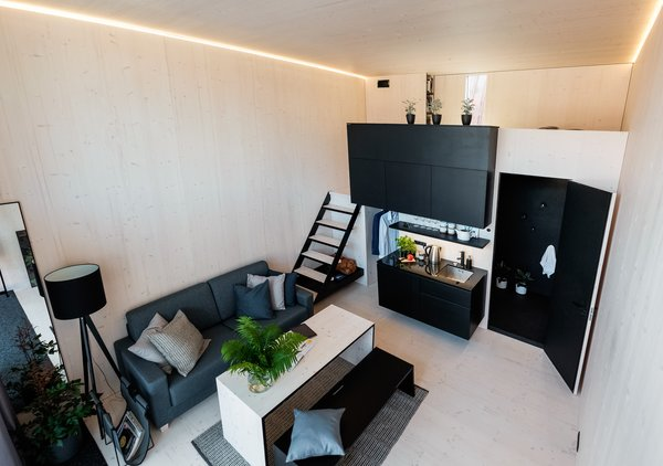 When set up as a rental unit, a KODA Concrete can accommodate two guests in the sleeping area and another two on a convertible sofa in the living area.