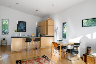 The kitchen/living/dining unit has an open plan with an L-shaped kitchen and island.