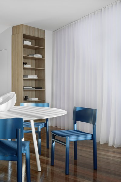 In the dining area, Billiani Design 'Blue' dining chairs from Hub Furniture are a bold but warm shade of blue that provides a welcome moment of contrast from the white walls and dining table.