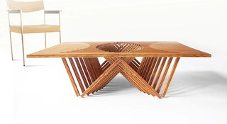 The Rising Table by Robert Van Embricqs transforms from a flat, almost two-dimensional surface into a three-dimensional table with a sculptural form.